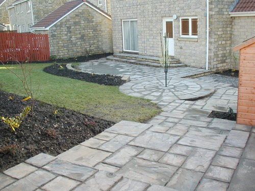 Bonnybridge - Complete: Different levels created in an existing sloping back garden using paving and brickwork we carried out the works within 4 days of commencing.